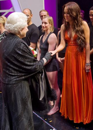 Miley Cyrus Wears Revealing Dress While Meeting The Queen